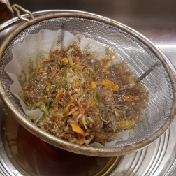 Straining aster and marigold from the dye pot