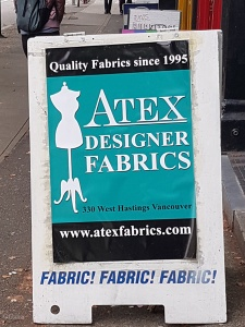 The sign outside Atex Designer Fabrics in Vancouver, BC.