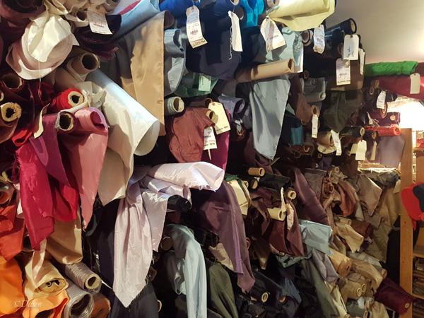 lots of rolls of fabrics at Atex Designer Fabrics in Vancouver, BC, Canada.