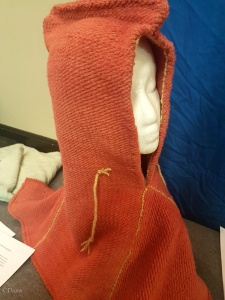 Handspun, hand dyed, and hand woven fabric to make a Skjoldehamn style hood for an SCA competition.