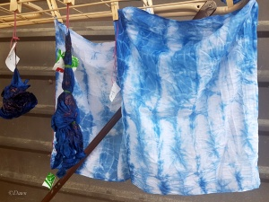 Accordion pleated handkerchief dyed with indigo, beside two other projects drip-drying.