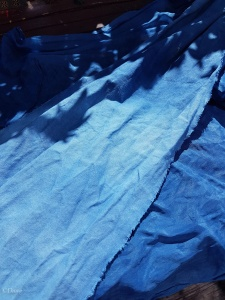 Dried indigo dyed linen on top of dried indigo dyed silk from our indigo vat dyeing day