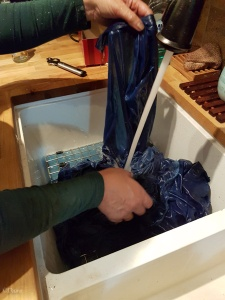 Rinsing the indigo dyed fabric in the sink.