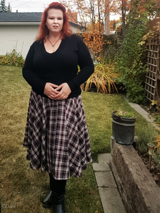 A bias-cut circle skirt in purple, white, grey and black even plaid