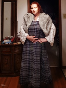 Plaid apron dress (hangerock) with a fake fur stole and white linen underdress. Adding new items to my Viking Age wardrobe.