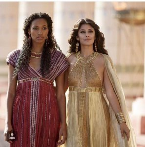 Pink dress with a surplus bodice worn by Suhad, in the tv miniseries Tut