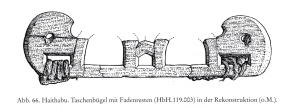 Wood speculated to be a Viking Age handle/frame from a bag found at Haithabu.