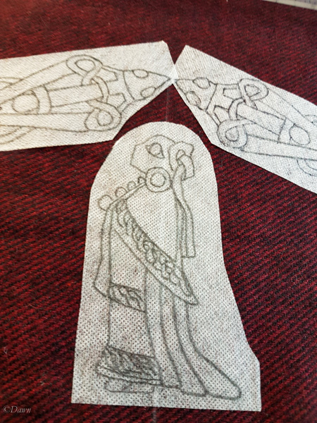 Laying out pattern designs for my red and black Viking apron panel