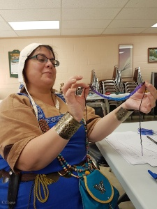 One student shows off her lucet cord in my introduction to lucet cord class at the Festival of the SnowEaters event in October 2017