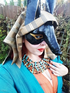 Goofing around in my Anubis mask with my new Egyptian costume - a teal and orange sheer layered costume featuring a sheath dress with sleeves and an empire waist, and a coordinating teal over layer.