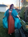My newest Egyptian costume - an orange loose sheath dress with 'sleeves' and a v-neck with a teal 'coat'.