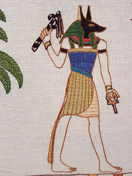 Anubis depicted in the Black Gold Tapestry