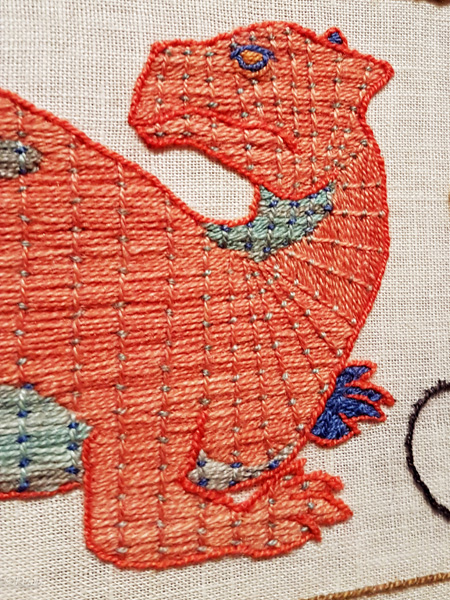Dinosaur detail of the Black Gold Tapestry