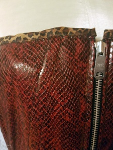 Close up on the red PVC snakeskin overbust Victorian corset