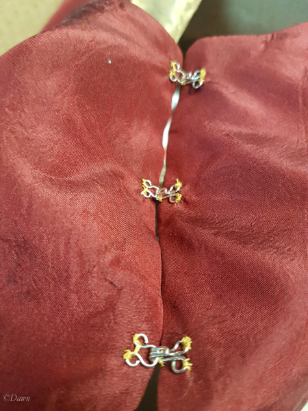Hooks and eyes on one shoulder over the Byzantine collar