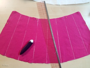 Drawing the initial stitching lines for the truncated hennin with chalk