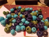 Turquoise, green, and dark blue/purple Faience beads