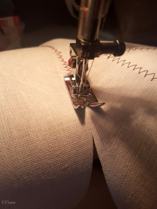 Butting the edges of the buckram up against one another and using a wide zig-zag to sew the pieces together flat.