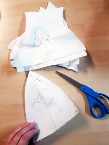 Cutting my horned hennin pattern pieces out of a thin quilt batting.