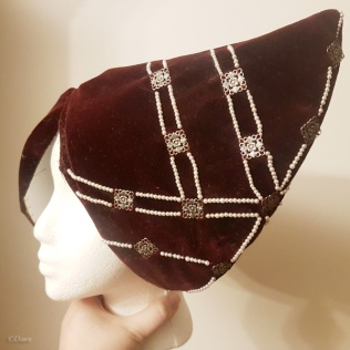 The horned hennin in progress - the hat has been beaded, but not yet lined.