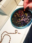 Stringing beads for a little necklace for largesse