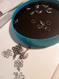 Picking charms for the largesse necklaces - a few celtic knots and a war axe