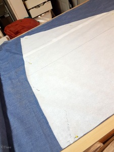 Cutting the Burgundian gown toile from blue chambray