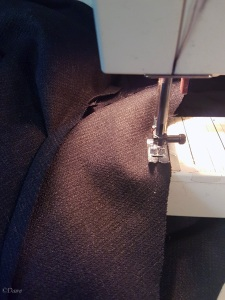 Sewing the hem facing to the bottom of the dress