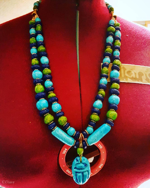 finished two-strand Egyptian faience necklace with scarab pendant