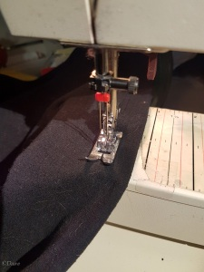 Hemming my tank top using a twin needle. This replicates a cover stitch - usually reserved for manufactured garments.