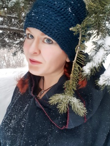 Selfie in a blue wool naalbound hat. I used the York Stitch for this hat.