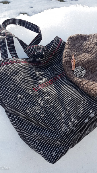 Black and white wool tote along with a naalbound hat and some of my Viking Age bling