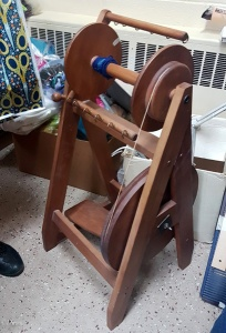 Spinning wheel for sale at the 2018 Grandmother's charity fabric sale in Calgary