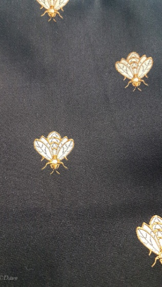 Insect print black and gold home-dec fabric - from the 2018 Grandmother's charity fabric sale