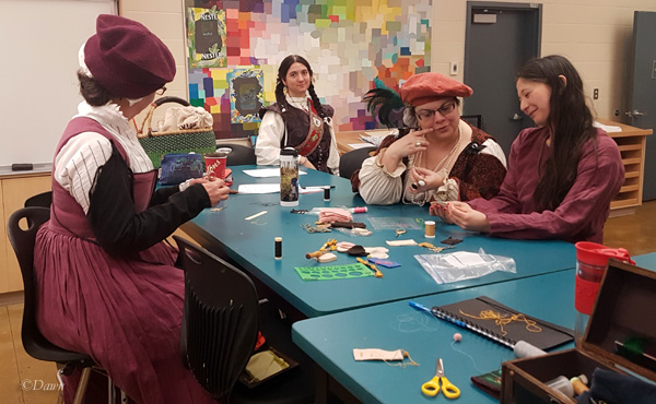 Students (and our teacher on the right) in the Cloth Buttons and Buttonholes class at Grand TUA 2018