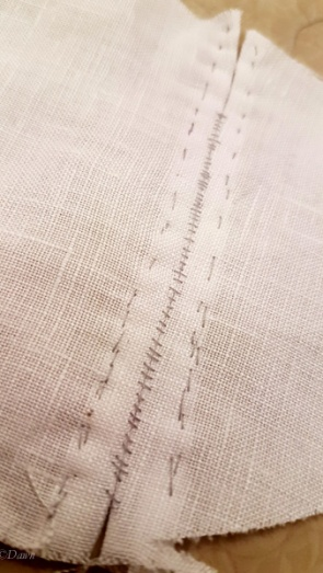 Finger-pressing the abbutted seam open, shows the ladder lines of stitching on the right side. If this were a garment and not a sample, I'd use the same colour thread as the fabric.