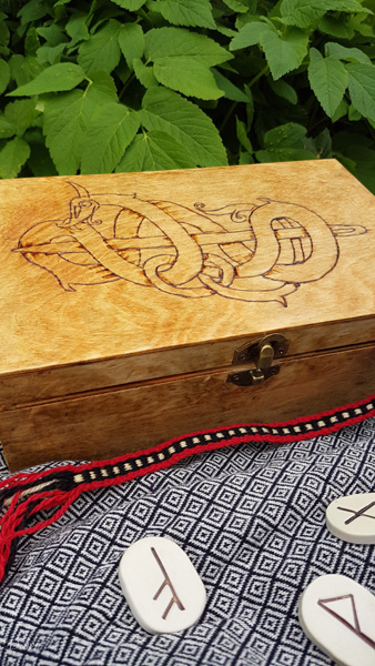 Finished Viking Age style box for my bling, sewing supplies, or tablet weaving. The design features a dragon/ serpent wrapped around a naalbinding needle.