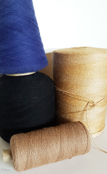 Blue, black, and brown wool cones and a huge spool of hemp from the Grandmother's Fabric Sale