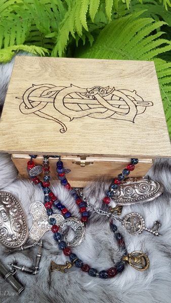 Small wooden trinket box with a pyrographed dragon design