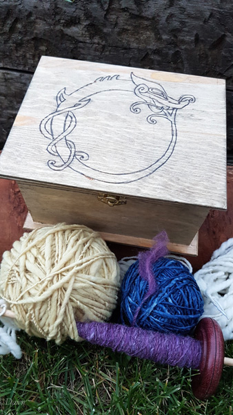 Viking-style Ouroboros design woodburned into a wooden box