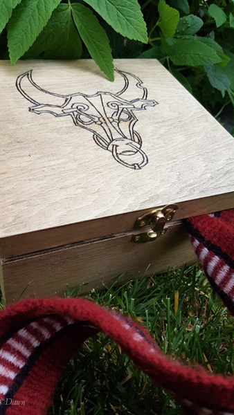 Minotaur in a Viking-inspired style, woodburnt into a wooden box to hold my tablet woven trim or other goodies