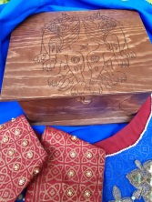 The top of this wood burned box was based on a 11th century textile.