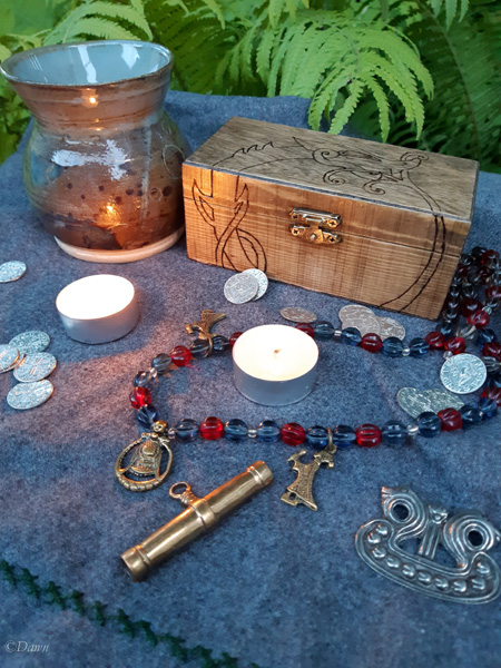 Small Jörmungandr wooden pyrography box displayed with some of my Viking costume kit, coins, and drinking glass
