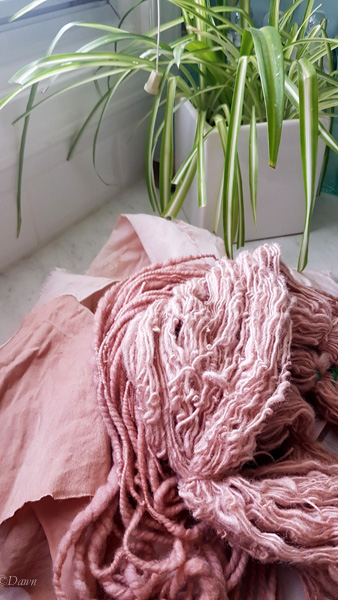 wool yarn and linen and silk fabric dyed with avocado