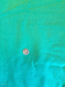 Kelly Green imitation linen. The swatch looks teal, but it's really a Kelly green. Quarter for scale of the texture.