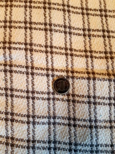 Brown and Off White Plaid Fabric. Quarter for scale of the plaid