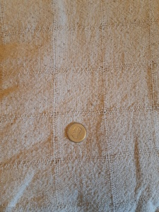 Tone-on-tone Off White Plaid Fabric. Quarter for scale of the plaid