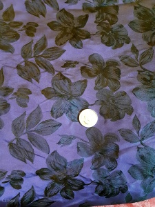 Purple and Black Floral Fabric showing how dense the floral pattern is throughout the fabric.
