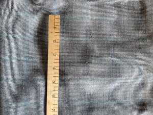 Faint blue stripe black and white wool fabric for sale