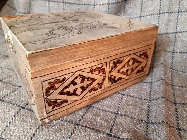 Side of the German Renaissance themed Pyrography box for my costume bling